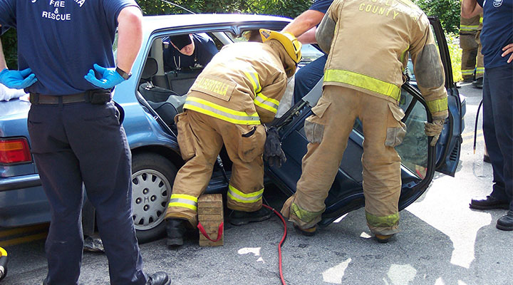 accident scene with fire and rescue responders