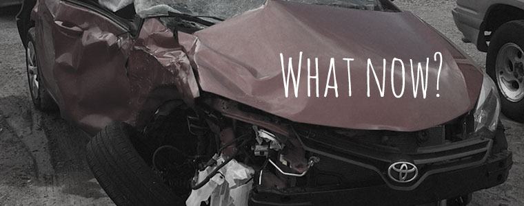 car with crumpled hood
